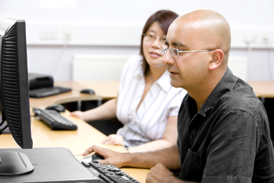 Man and woman at computer.