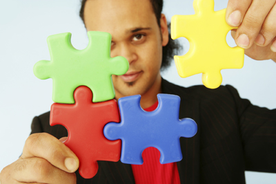 Man holding puzzle pieces.